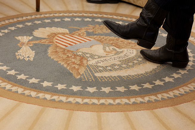The boots of Office of Management and Budget Director Peter Orszag during a meeting with President Barack Obama in the Oval Office, Feb. 16, 2010. (Official White House Photo by Pete Souza)